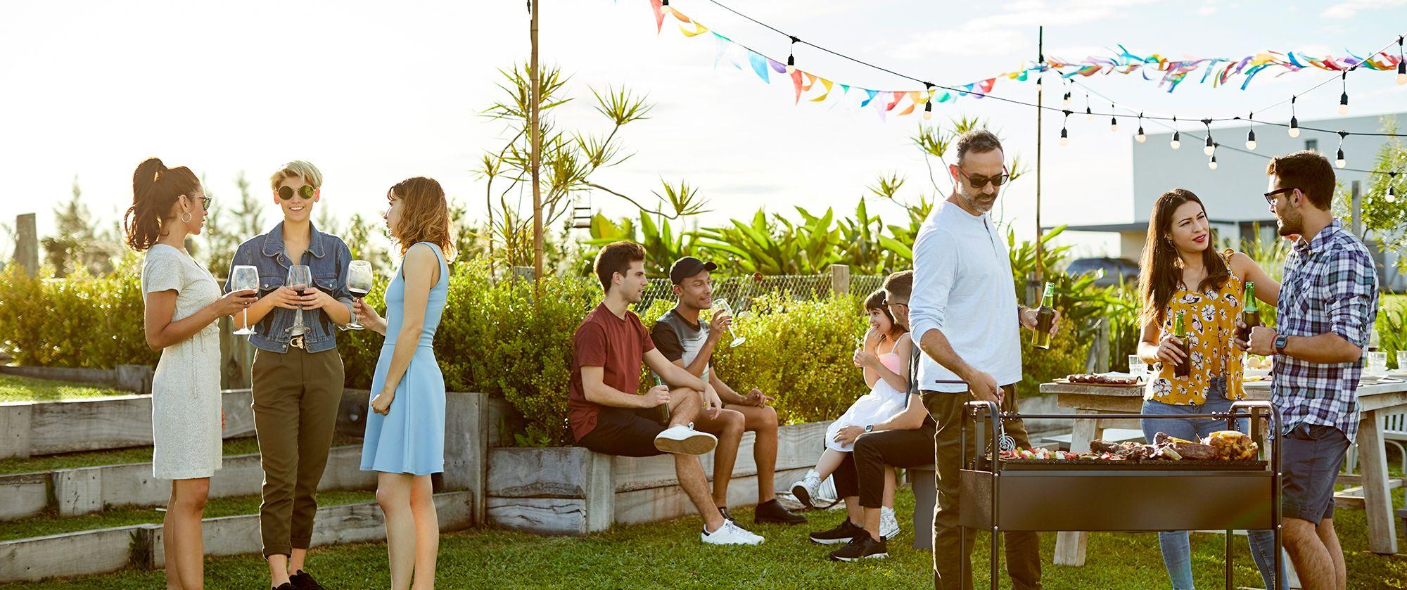 People having a BBQ in a backyard.