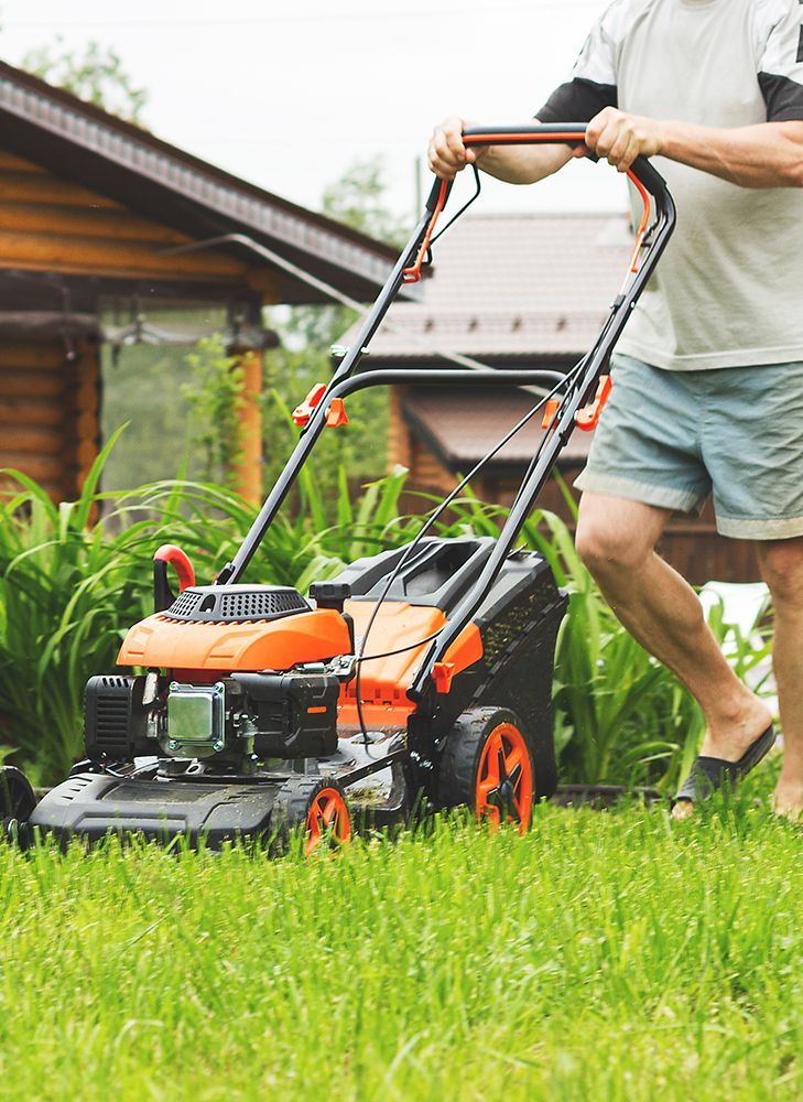 Man mowing his lawn.